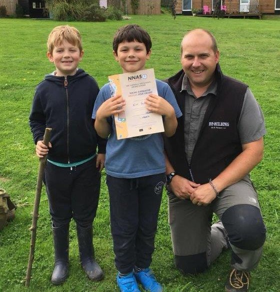 Children receiving their Navigation & NNAS Training Certificates | Rewilding Adventures