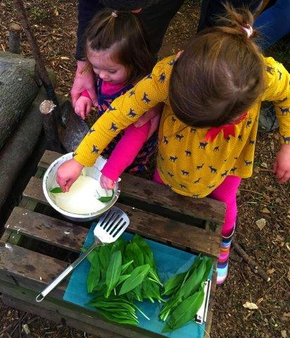 Dipping wild garlic in batter